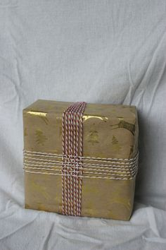 Try this for a wrapping idea - either plain brown kraft or patterned and use Baker's Twine to weave round it. Looks really effective and very simple.