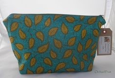Zipped make-up bag (larger size) -deep blue with green leaves fabric by OrchardFruit on Etsy