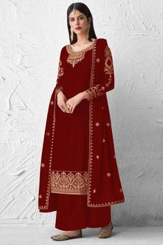 Look elegant when wearing this deep red georgette trouser suit which will definitely make other's envious of your look. This U-neck and full sleeve trouser suit highlighted with thread work and stone work. Paired with santoon palazzo pant in deep red color with deep red georgette dupatta. Palazzo pant is plain. #trousersuit #salwarkameez #malaysia #Indianwear #Indiandresses #andaazfashion