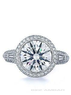 Bez Ambar Round Brilliant in knife edge mounting. #engagementrings #weddings…