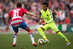 Neymar JR. (R) of FC Barcelona competes for the ball with Roberto Ibanez (L) of Granada CF during the La Liga match between Granada CF and FC Barcelona at Nuevo Estadio de los Carmenes on February 28, 2015 in Granada, Spain.
