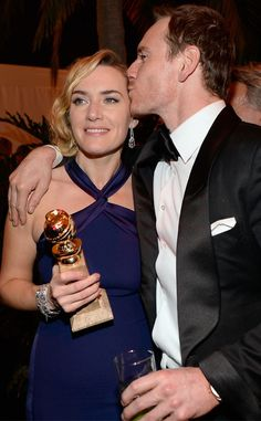 Kate Winslet & Michael Fassbender from 2016 Golden Globes: Party Pics  The Steve Jobs nominee planted a kiss on his castmate's cheek in celebration of her Best Actress win at the NBC, E!, Universal & Focus Features Golden Globes Party—sponsored by Chrysler.