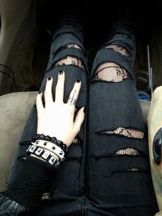 I'm definitely doing this look! Ripped jeans + Cute black tights, with just right amount of arm candy and painted nails. :)