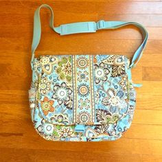 Vera Bradley Messenger Bag Good condition. The only sign of wear I can see is shown in the fourth picture, the handle has some discoloration. Plenty of space, lots of pockets, and the back also has a zip pocket. Light blue with brown, green, and navy accent colors. Vera Bradley Bags