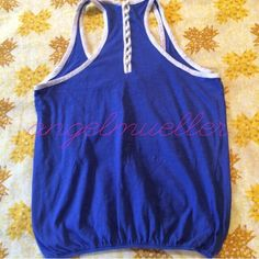 """Blue sport tank. This cotton tank is blue, with white trim. May be used as a workout top or just a every day tank. 8 small white buttons line the racerback style. Elastic at the waist. Length: 21.5"""", bust: 17.5"""". Fits like a small. Stretchy. Tops Tank Tops"""