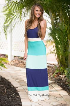 This is the perfect outfit for watching the sunset on the beach! Colorblock style dress with colors in navy, teal, mint, and off white with adjustable straps! Add wedges or sandals and you have a stunning look!