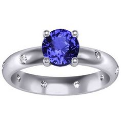 Sapphire Nova Ring with a natural round blue 6mm Ceylon sapphire | brilliantearth.com