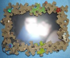 """Puzzle Picture Frame, we do this for Mother's Day and put a little sign on it that says """"Love you to pieces""""."""
