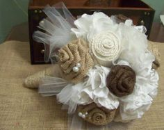 burlap, ivory, champagne, and lace. if those constitute as colors, that's what I'm going for