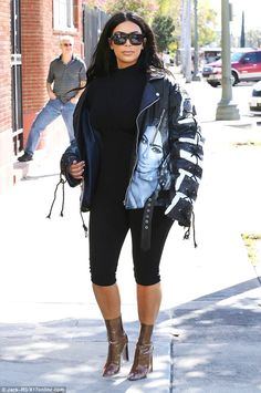 Kim Kardashian steps out in Yeezy perspex boots and spray painted biker jacket | Daily Mail Online