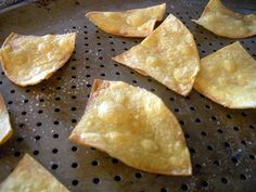 how to make tortilla chips. You just need corn tortillas, olive oil and salt, brush olive oil on corn tortillas, cut into triangles, salt and bake for 10 min at 350