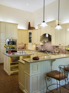 See a cottage kitchen with cream-colored cabinet on HGTV.