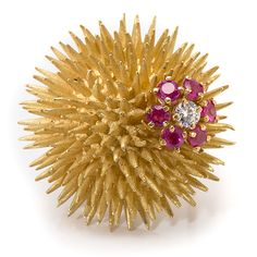 Tiffany & Co. 18 Karat Sea Urchin Pin with Diamond and Rubies, 18k yellow gold sea urchin pin from Tiffany & Co., ca 1950. Double pin back with one VVS2, F-G color round diamond and six 2.5mm round rubies.