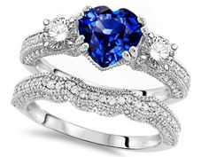 Heart Shape Sapphire Engagement Wedding Set - A combination of beauty with this 7mm Heart Shape Sapphire Engagement Wedding Set stamped in 925 Sterling Silver within a prong setting. It features an adorable Blue Sapphire Created Heart Shape gem set atop of the ring with an additional 60 very lovely round Brilliant Cut Cubic Zirconia accent diamonds that surrounds it. This incredible ring measures 15mm & all of the accent diamonds are synthetic but not heat-treated. #unusualengagementrings