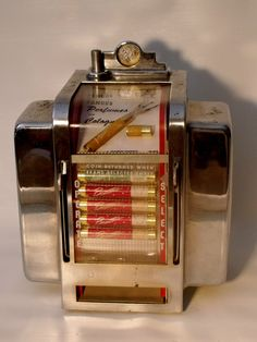 Rare 1950s coin-op perfume dispenser by Globe; paper napkin holders on each side for convenience.