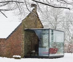 Belgian architect Bruno Erpicum has been practicing for 25 years, creating a portfolio of finely detailed modernist buildings and interiors. We especially like this small stone outbuilding in the Belgian countryside, which Erpicum transformed by introducing steel sheets into the existing structure to create a mezzanine floor. He extended the steel sheets to the outdoors, fabricating a glass-enclosed living room pavilion that offers sweeping views of the surrounding countryside. Go to Atelier d'Architecture Bruno & Partners to see more of the firm's work. Photographs by Jean-Luc Laloux.