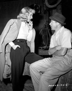 wilderthanbilly:    Barbara Stanwyck and Billy Wilder on the set of Double Indemnity 1944