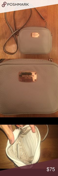 Michael Kors Crossbody White MK crossbody bag with gold accents. 4 card holders and pocket inside. Used but in good condition, scratches on the front plate shown in picture Michael Kors Bags Crossbody Bags