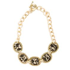 Leighton Necklace  If you like your bling on the chunky side you'll love the Leighton necklace with textured gold ovals, large smoky topaz stones and toggle closure on an oversized chain.