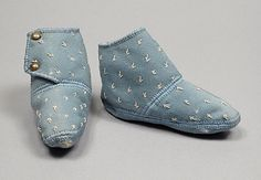 Cute wool baby booties with embroidered detail, made in the US circa 1850.