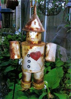 Tin Man - Garden Decoration - If I Only Had A heart :)  This reminds me of the security alarm we had outside out bedroom as kids ~ tin cans all strung together :)