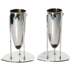 Pair of Archibald Knox for Liberty & Co Cymric Art Nouveau Silver Vases   From a unique collection of antique and modern sterling silver at https://www.1stdibs.com/furniture/dining-entertaining/sterling-silver/