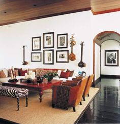 kid rock's living room, where antique sitars hang with photos of rock royalty