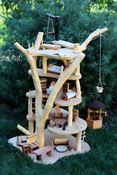 How stunning is this? Beautiful and rugged handmade, hand-carved treehouse. 5-stories to play with, including pulleys for playful functionality and lots of delightful furniture! More photos on this link: http://castleofcostamesa.com/waldorf-days/the-waldorf-school-of-orange-county-2013-annual-gala-auction/wooden-tree-house-with-furniture-set