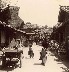 """OLD MEIJI JAPAN -- Rustic Road through a Rural Town By T. ENAMI. A Rustic Street scene in Rural Japan. Possibly photographed in or near Hakone. This is a half-stereoview from an original, untransposed 3-D contact proof.   Written in Japanese characters on the center septum of the negative is the number """"45"""". It appears to be one of his earliest stereoviews from the 1895-98 period."""