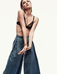 Karlie Kloss models bra and wide-leg pants