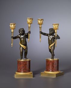 A pair of Empire gilt and patinated bronze and rouge griotte marble two-light candelabra attributed to André-Antoine Ravrio, Paris, date circa 1805
