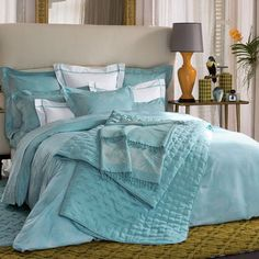 Yves Delorme Tropics bed linen a beautiful robin egg blue bed set... reminds me of carribean blue seas and sparkling bay waters.