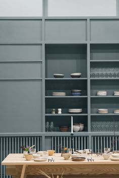 Blue grey built in storage inspiration for a kitchen/dining room | Alma creative space Stockholm by Tham & Videgård