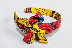 Hair band made from the popular Ankara (a type of African print) its soft and gentle to the skin. Give yourself that much needed Afro pop on your outfit of the day with these beautiful hair piece African Accessories, Flower Hair Accessories, African Jewelry, Handmade Accessories, Fabric Necklace, Fabric Jewelry, African Dresses For Kids, African Kids, African Clothes
