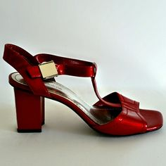 $22. (MRP $60.) Patent Leather T-Strap Heeled Sandals - Size 7. Beautiful ruby red shoes by Liz Claiborne. I love the silver detail on the back of the heels! Clamp style closure. Sexy and well made; genuine leather. Size - 7 Label - Liz Claiborne Materials - Leather Color may vary slightly based on screen display. #red #strappy #silver #tstrap #shiny #shinyshoes #patent #lizclaiborne #leather #leatherheels #redleather #patentleatherheels #patentsandal #heeledsandals #heeledsandal…