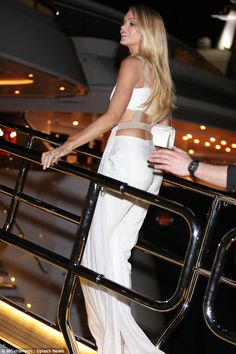 A vision: Lindsay opted for a white cut out dress as she too attended the yacht bash ...