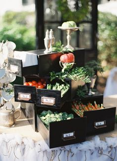 """Vintage file drawers holding crudités on one of the appetizer tables. Catered by Inlet Affairs of Murrells Inlet, vignette by """"I Do"""" Vintage Weddings"""