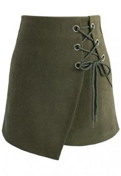 Step up your miniskirt collection with this lace-up army green piece. Its asymmetrical flap and jumbo lace-up detail makes it a fun party piece. Pair with your favorite turtleneck, a leather moto jacket, stockings and boots for an edgy yet sophisticated look.  - Lace-up decoration - Concealed back zip closure - Lined - 100% Polyester - Hand wash  Size (cm) Length Waist  Hip  XS        40    66   86 S         40    70   90 M         41    74   94…