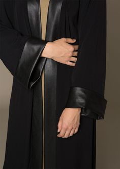 """<div class=""""page"""" title=""""Page 7""""> <div class=""""section""""> <div class=""""layoutArea""""> <div class=""""column""""> <p><span style=""""color: #000000;"""">A modish kimono that features leather trims on the sleeves and front, made with a fluid fabric that provides you with ultra movement and class.</span></p> </div> </div> </div> </div>"""