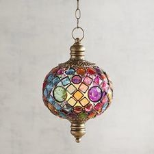 Decorated with colorful, jewel-toned acrylic gems, our handcrafted hanging lantern evokes a Moroccan bazaar as it casts colorful shadows and sets your interior in just the right light. Star Lanterns, Hanging Lanterns, Candle Lanterns, Solar String Lights, String Lights Outdoor, Chandeliers, Outdoor Decorative Lights, Acrylic Gems, Lantern Chandelier