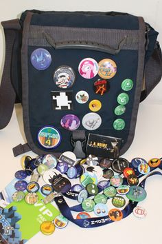 creative uses for pinback buttons - book bags are a great canvas for displaying groups of smaller buttons #coolbuttons #littlebuttons