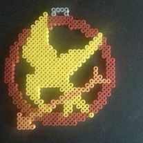 Katniss's Mockingjay the symbol of hope and rebellion in dark days. This one is designed to be used an ornament but can be used as a magnet if requested.   I hand-craft these adorable magnets, hanging ornaments, and wall décor in my home. They make fun refrigerator magnets, children's room déco...