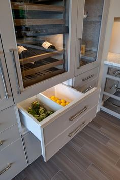 Integrated cooler drawers hang below the Sub Zero wine cooler.