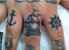 anchor, ship and ship wheel finger tattoo