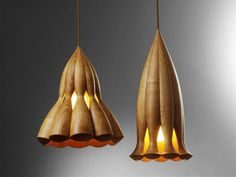 15 Wood Pendant Lights That Add A Natural Touch To Your Decor // These smooth wood artistic lamps were inspired by jellyfish.