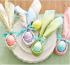 easter themed napkins wrapped around easter eggs in the shape of bunny ears