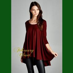Perfect Swing Top Only a few sizes left! Look glamorous in this loose fit, three-quarter length sleeves, round neck, hi-low swing top. Made with lightweight knit fabric that is soft, drapes well and has good stretch. Pair with leggings or jeans. Color: Burgundy. Tops Tunics