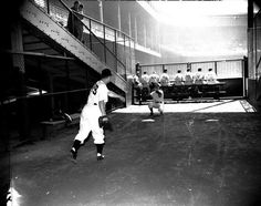 Detroit pitcher Stubby Overmire, warming up in bullpen, at Briggs Stadium in the 1940's.