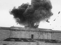 The US Army blowing up the swastika above the Nazi parade grounds in Nuremburg, c.1945