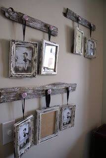 Reclaimed bar wood and nobs make a good way to display pictures.